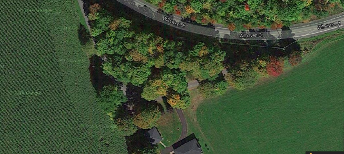 Aerial view of the 0.408 acre building lot on the south side of the road