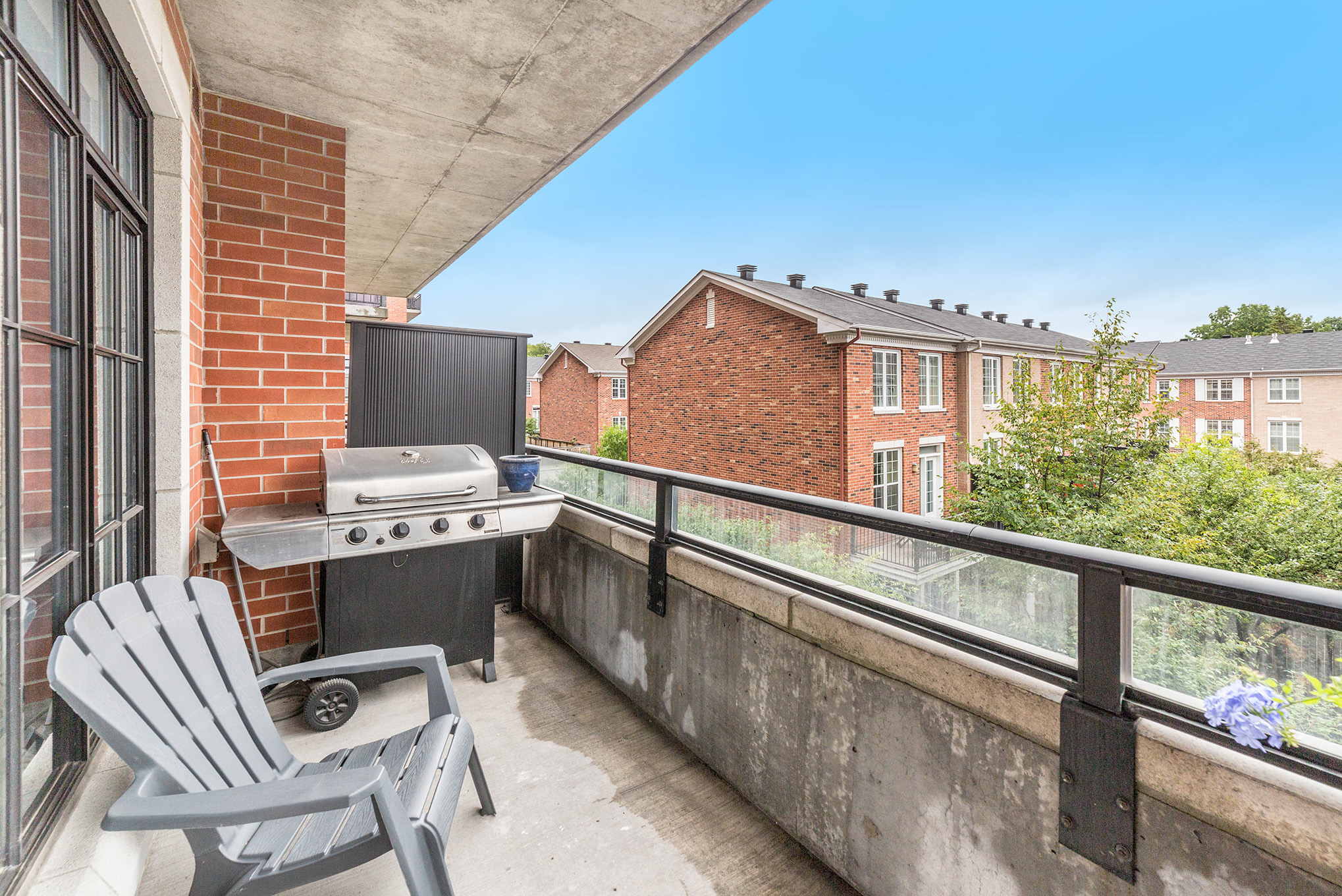 Spacious balcony with a natural gas hookup for BBQ.
