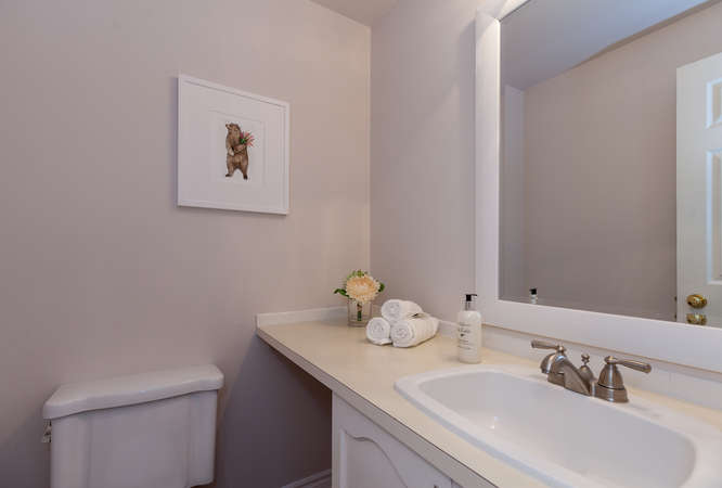 Cute and spacious powder room located on the main level