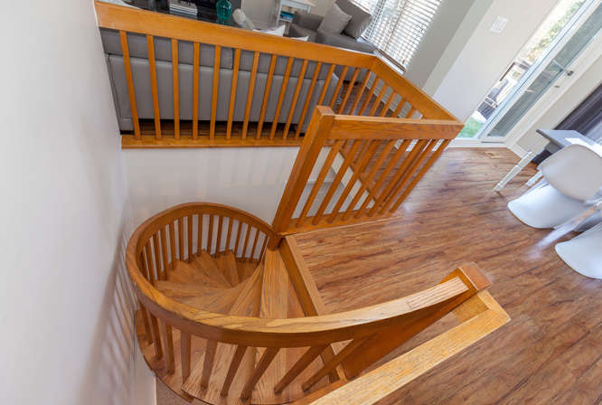 Beautiful Spiral Oak Staircase that heads downstairs to the family room with walkout.