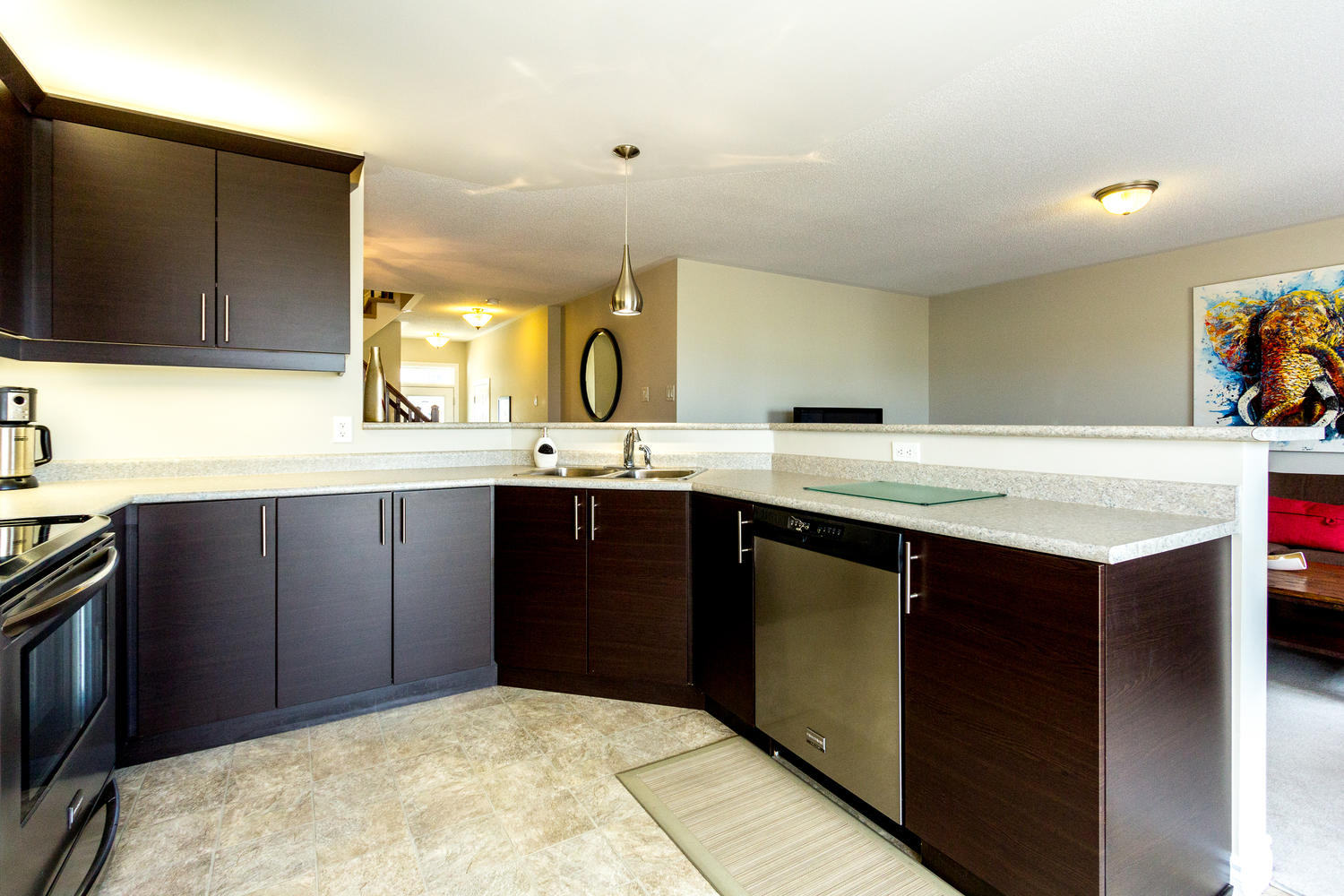 Large Chef's Kitchen.  full open concept, loads of counter and cabinet space, stainless steel appliances, massive breakfast bar that can sit 6-8 people comfortably.