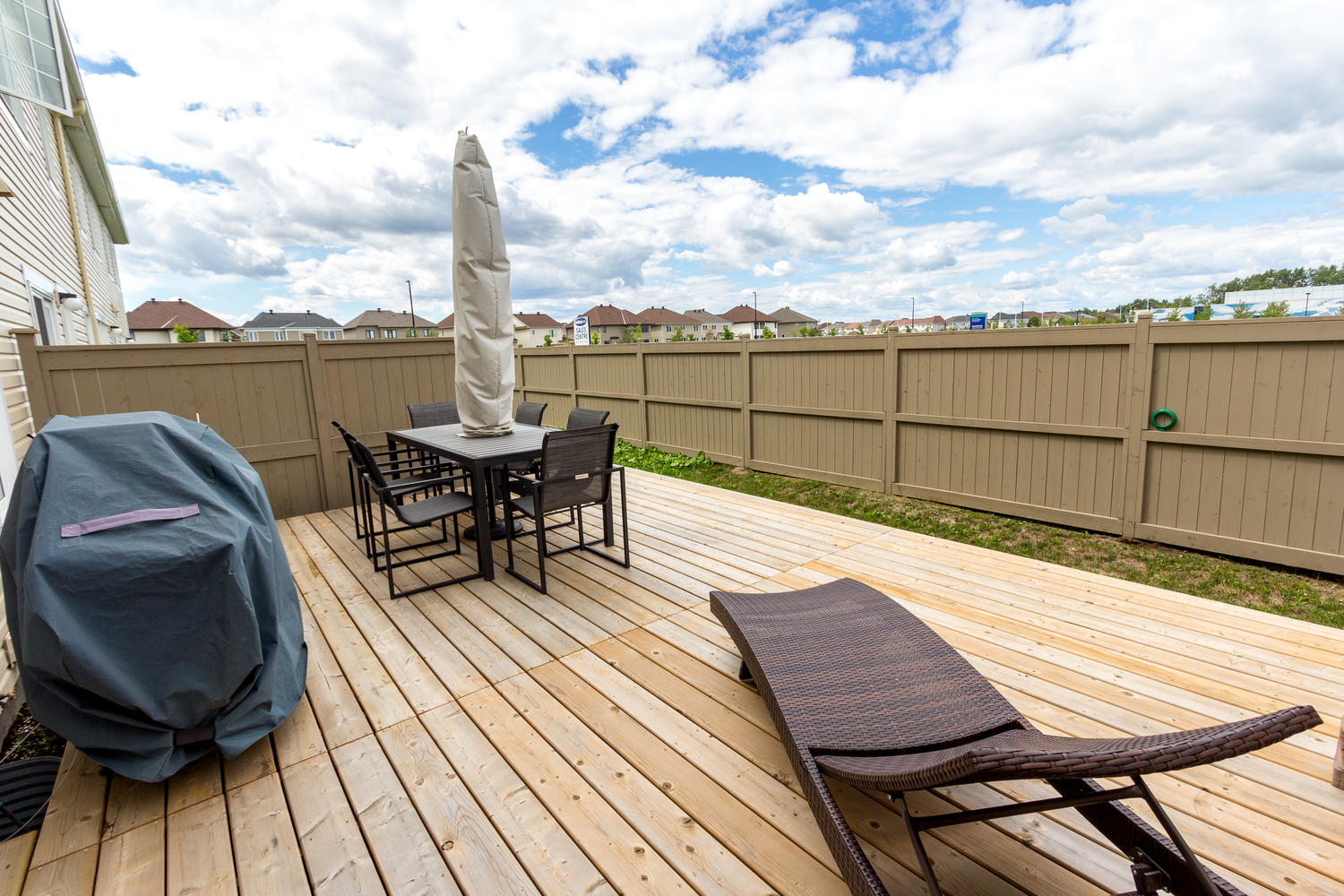 Large Deck in the Backyard, Perfect for BBQ's, Entertaining, and watching the sunsets.
