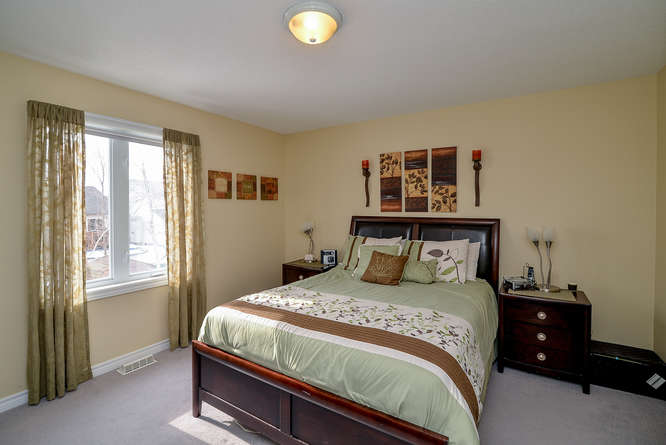 Spacious Master bedroom with cheater ensuite and a walk in closet