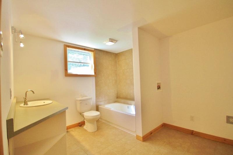 Main level bath with laundry area
