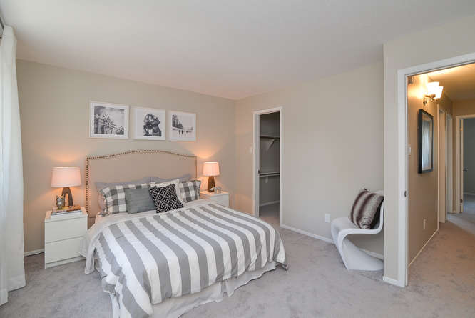 Spacious master bedroom with large walk-in closet, new plush carpets, stunning master ensuite