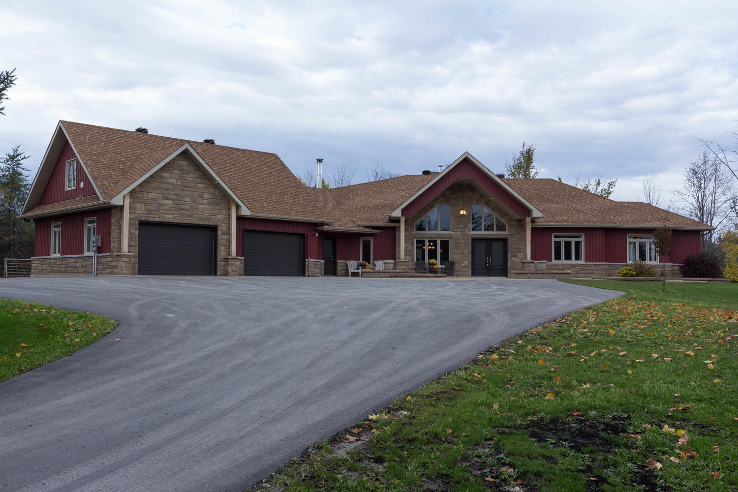 14105 Concession 7-8.  A beautiful custom built bungalow on 5 Acres with 3 bedrooms, 3 bathrooms, and a stunning open concept design.