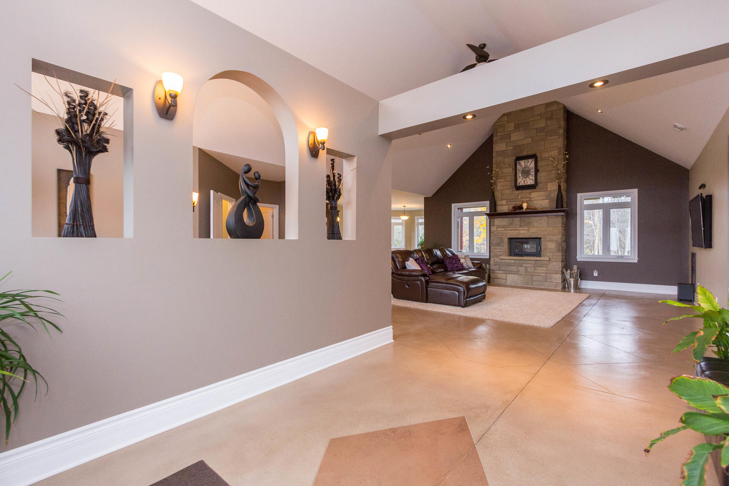 From the first step into this home, you will be blown away.  Large vaulted ceilings, large bright windows, heated concrete flooring, and open concept living.