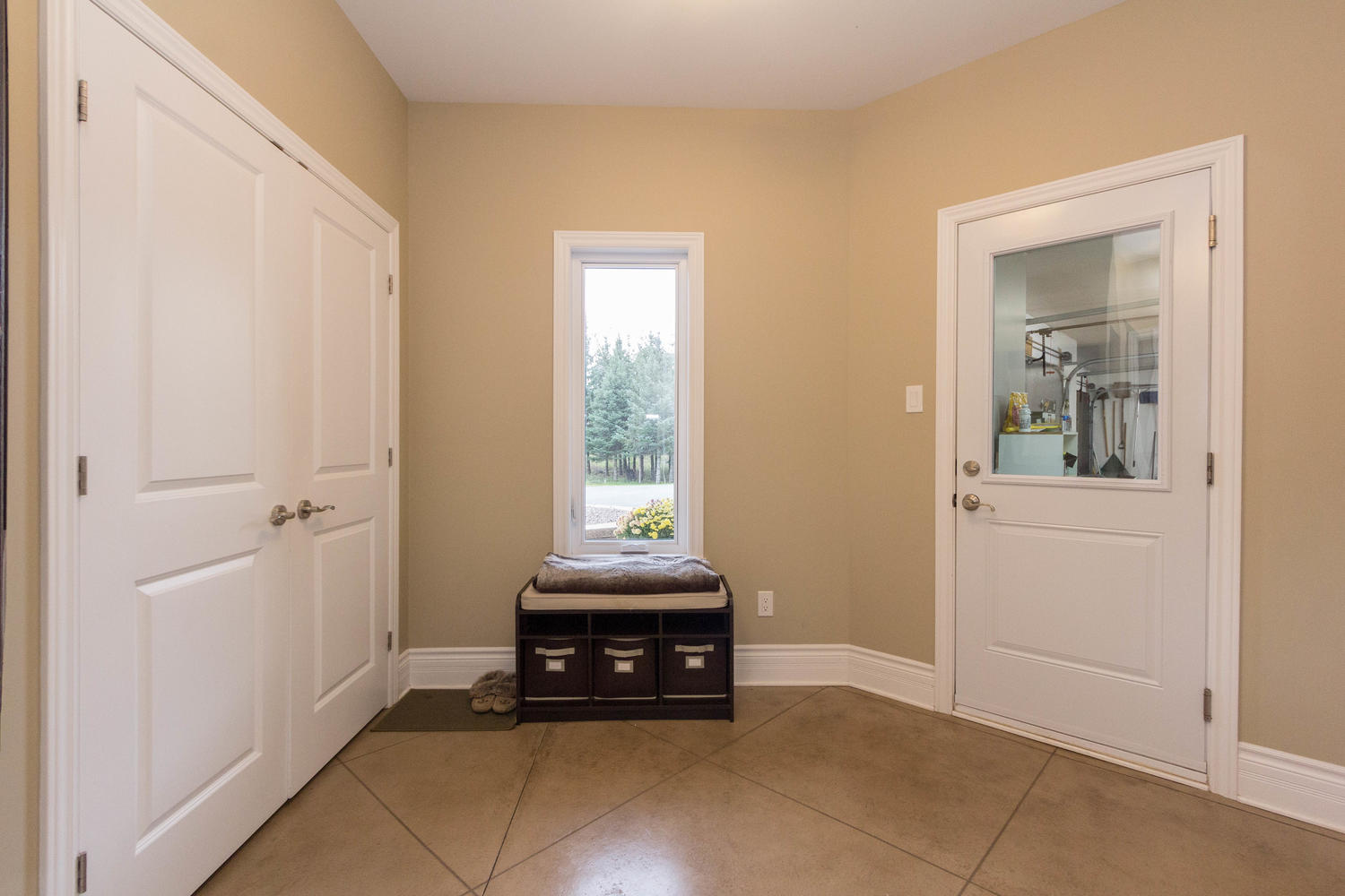 When you are done playing with your toys and need to come in, come in through the garage and through this very spacious mud room with lots of storage space.