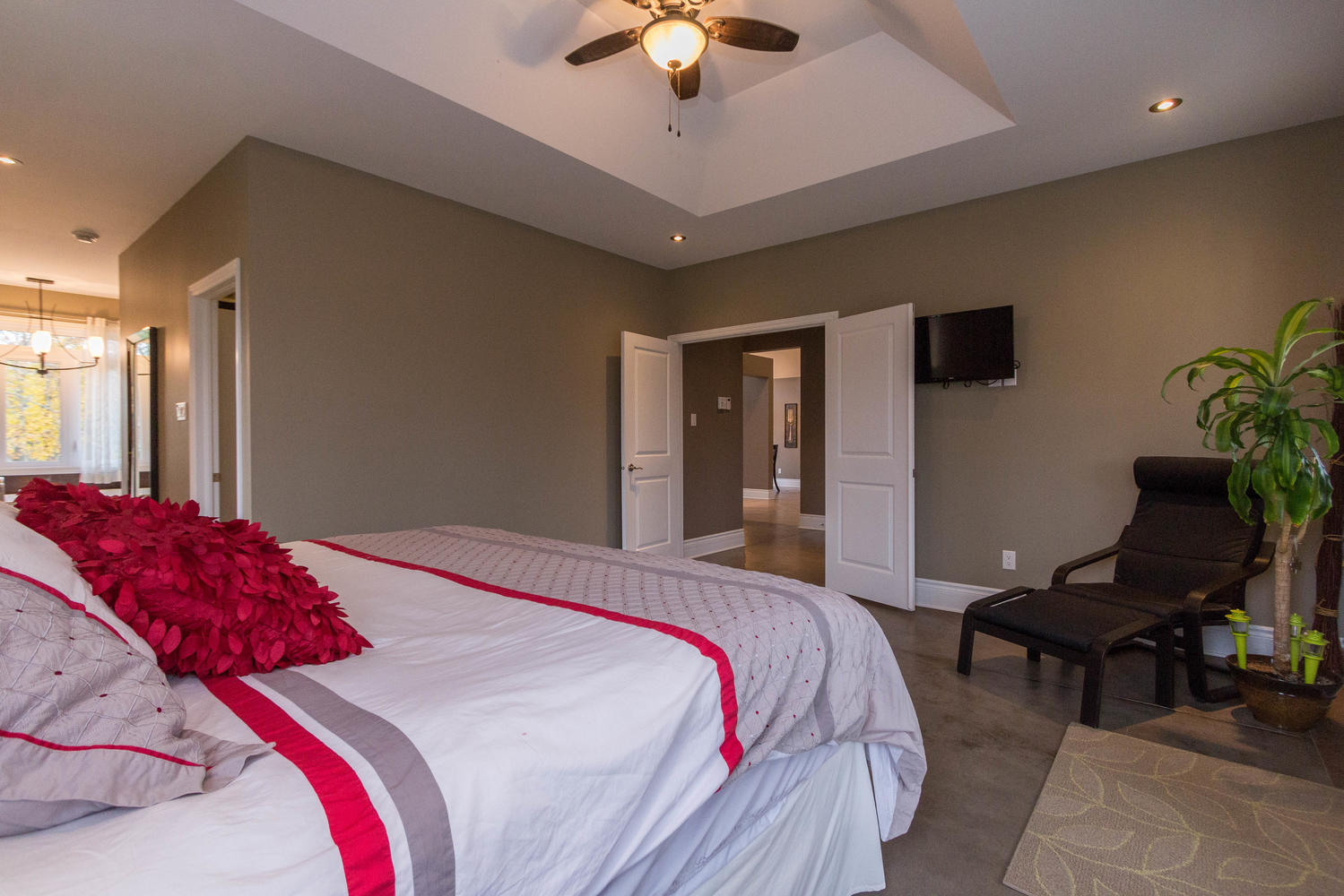 A master bedroom that will blow you away!  Very spacious to fit any bedroom set you have, Double doors leading out to the covered back deck(Hot tub in the future?) two large walk in closets, and a master ensuite with large soaker Jacuzzi tub and walk in tiled shower with his and her showers.