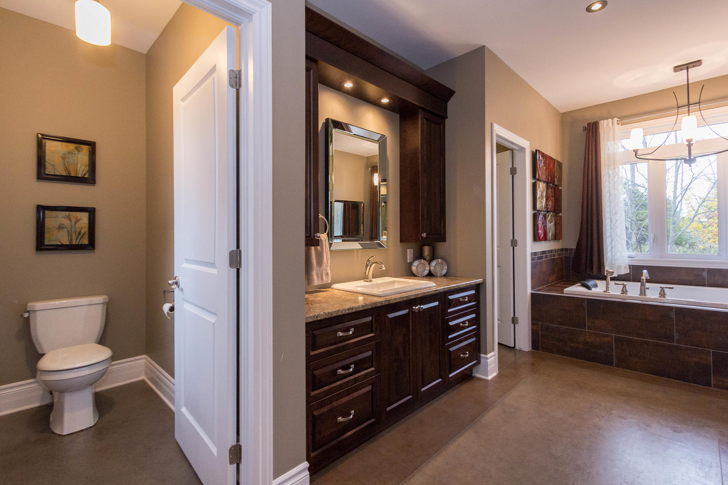 Beautiful vanity, separate toilet area, branches off to two walk in closets, large Jacuzzi tub, massive walk in shower with his and her showers