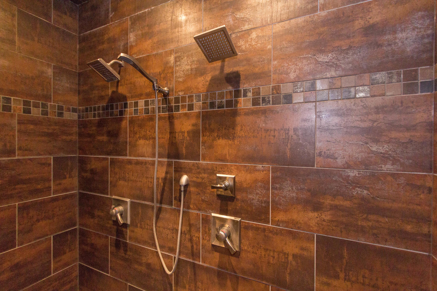 Gorgeous tile work and two shower heads.  Room for a party in here!