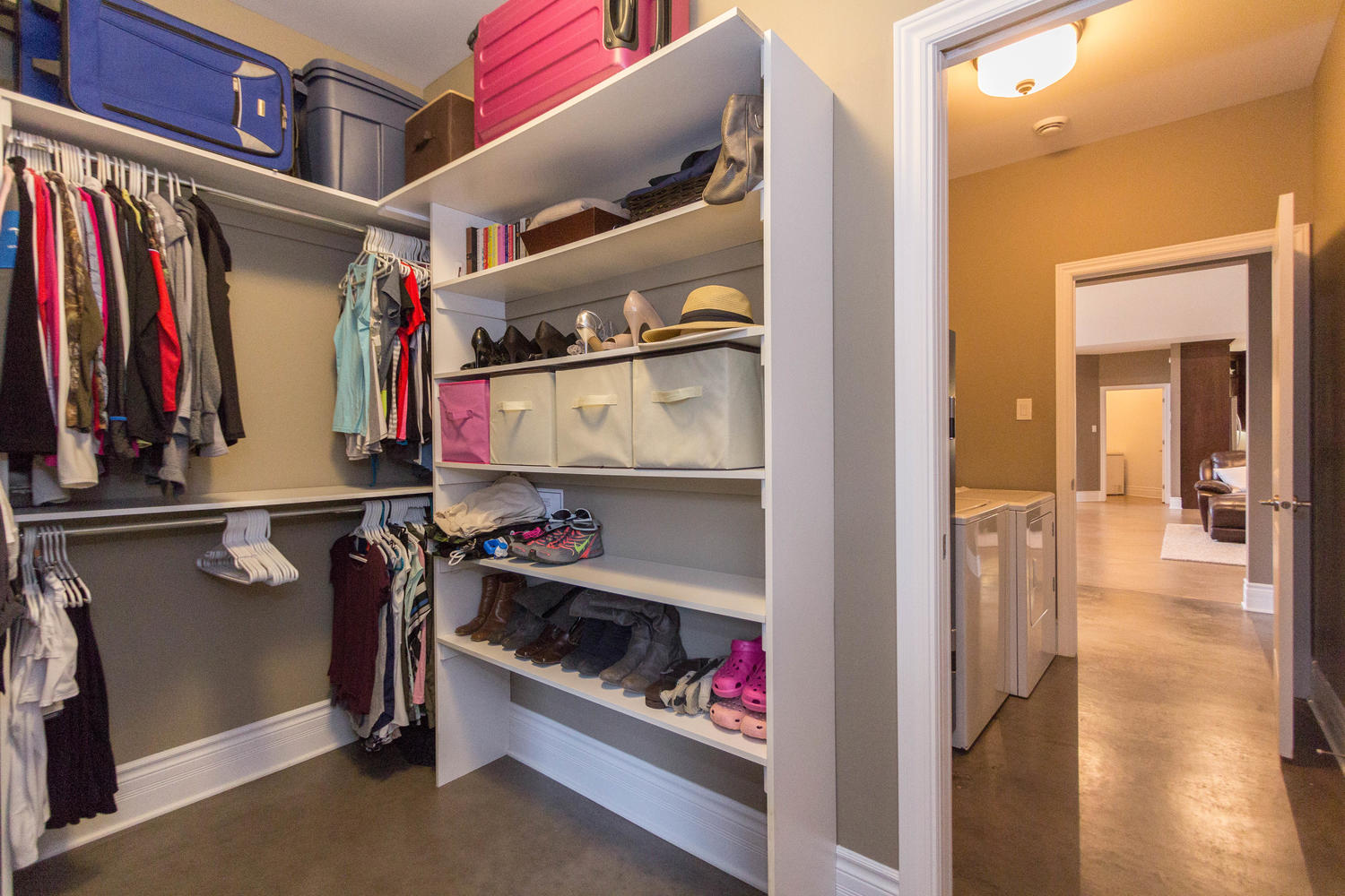 One of two walk in closets, this one has a pass through to the laundry room as well.