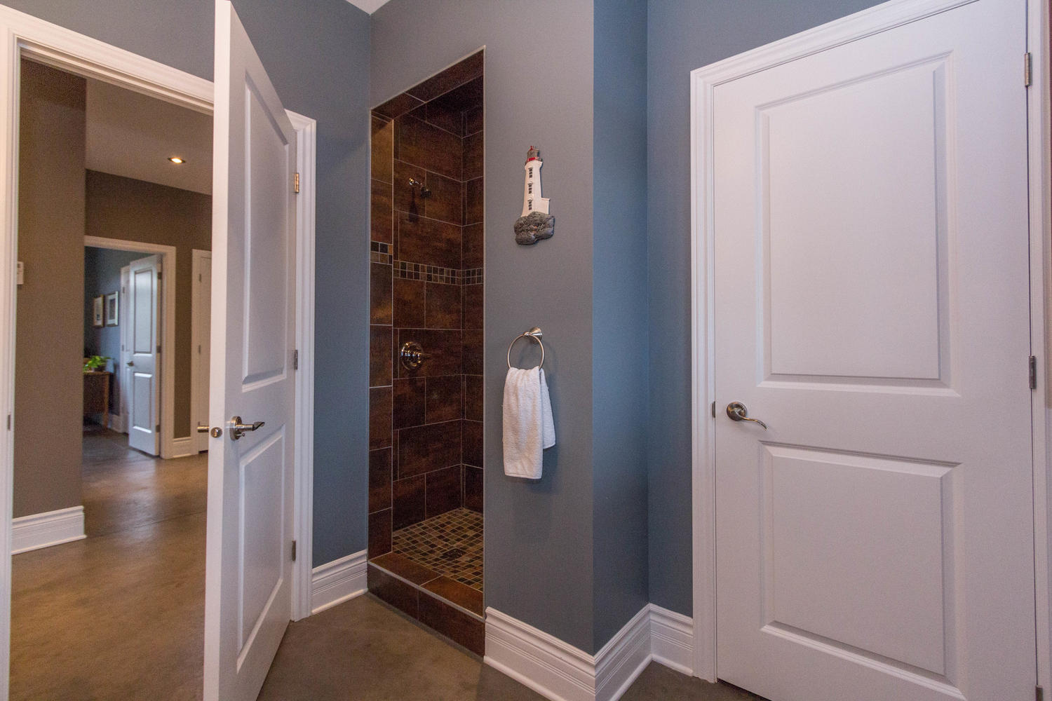 Second washroom with large and spacious tiled shower.