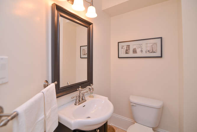 Conveniently located on the main level is your powder room.