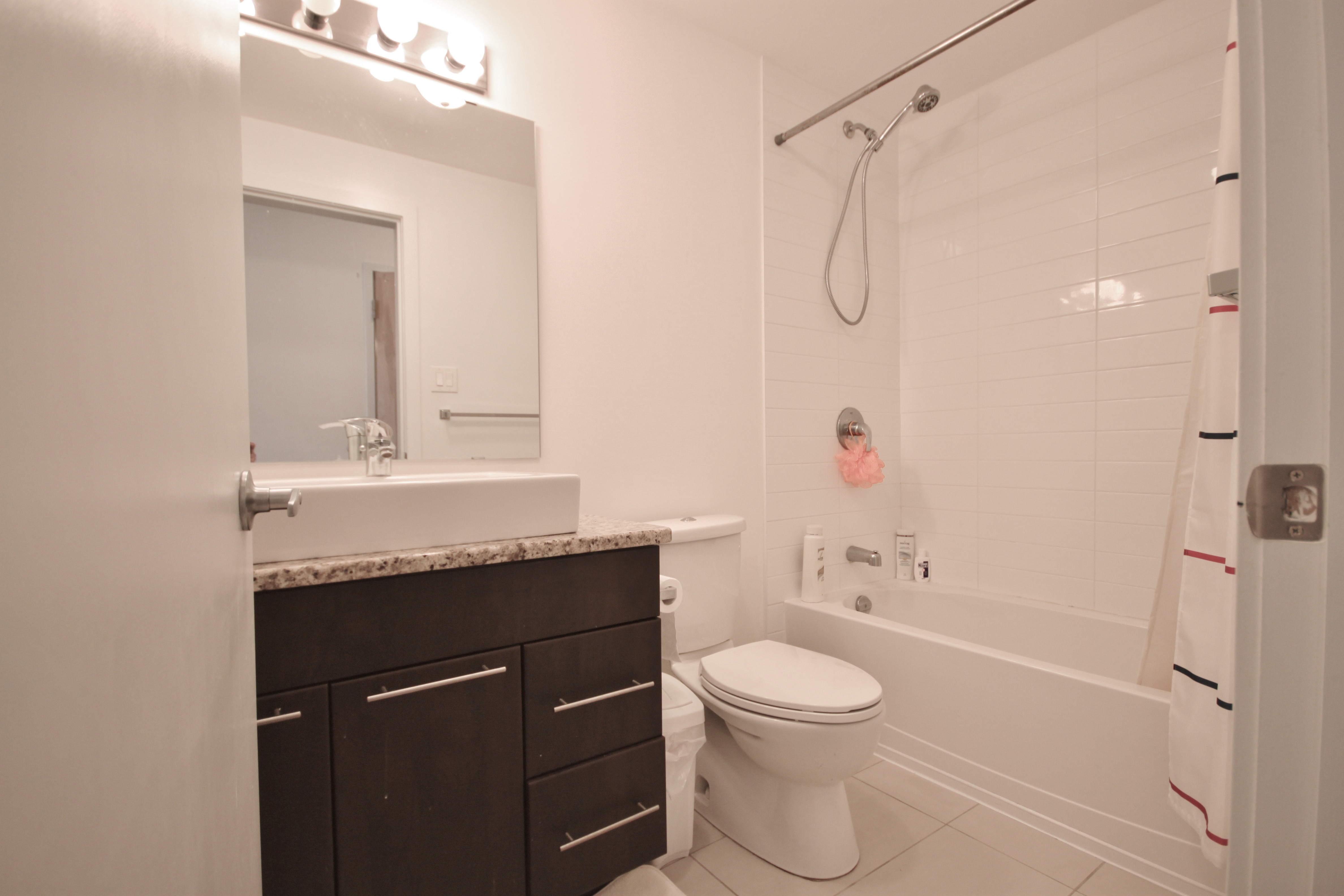 Beautiful bathroom with lots of storage space, ceramic tiled flooring, tiled shower with tub.