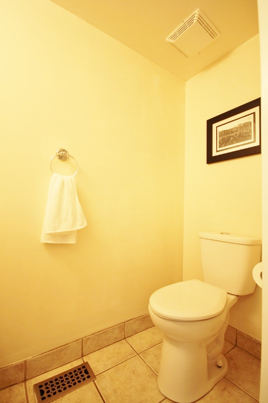 Powder room located on the main level, new low flush toilet, freshly painted.