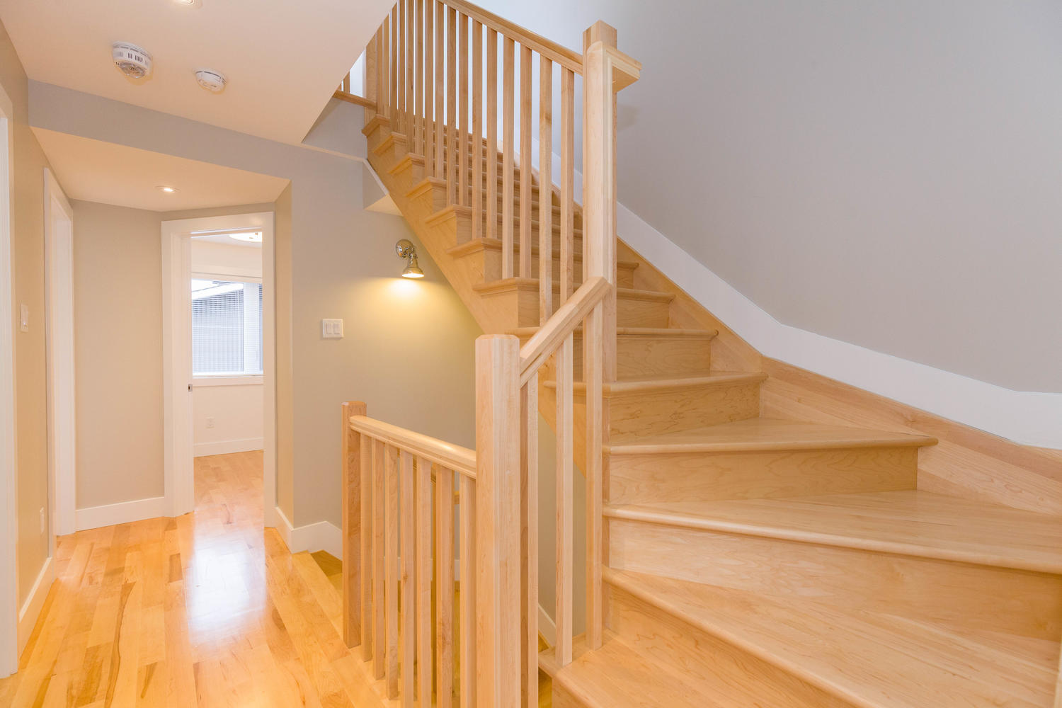 Gorgeous wood stair cases top carrying you up 4 floors.