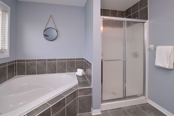 Luxurious master ensuite with large soaker tub and stand up shower.