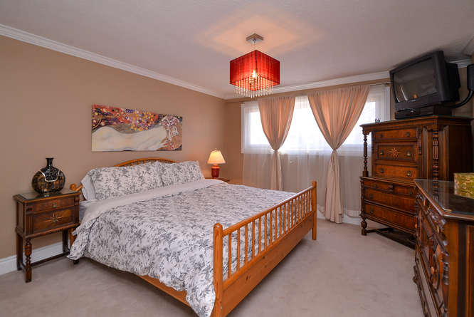 Spacious master with plush carpeting that can accommodate a king bed(as shown) and still fit other large pieces.