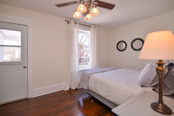 Large master bedroom, with walk out to balcony, hardwood floors, lots of closet space.