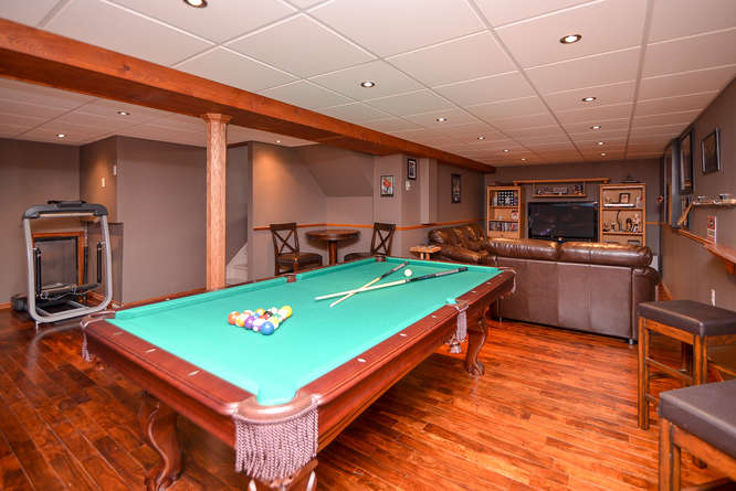 Been searching for a home with a man cave!?  This is IT!  Huge amount of space in the basement family room.  Beautiful flooring and pot lighting throughout.  Call over the boys, its Game Time!