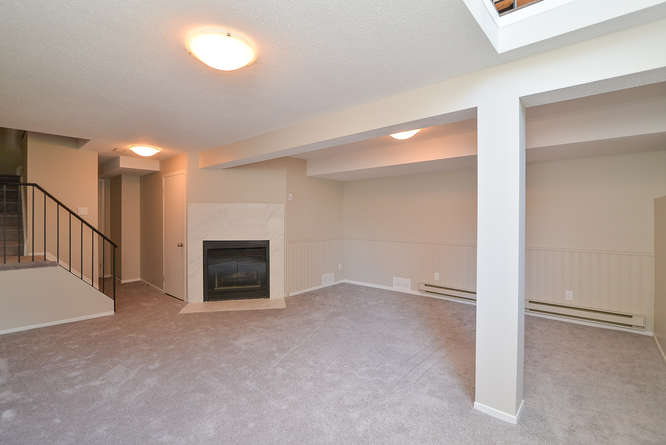 Lower Level Family room with 2 storey windows and a natural gas fireplace