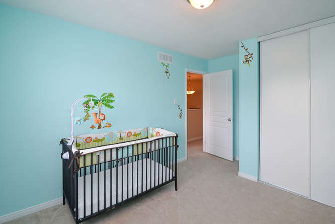 Spacious third bedroom.  Can be repainted if need be prior to closing, but currently a cute little nursery.
