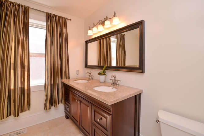 Main bathroom on the second level with granite counter tops, soaker tub, stand up shower and his and her sinks.