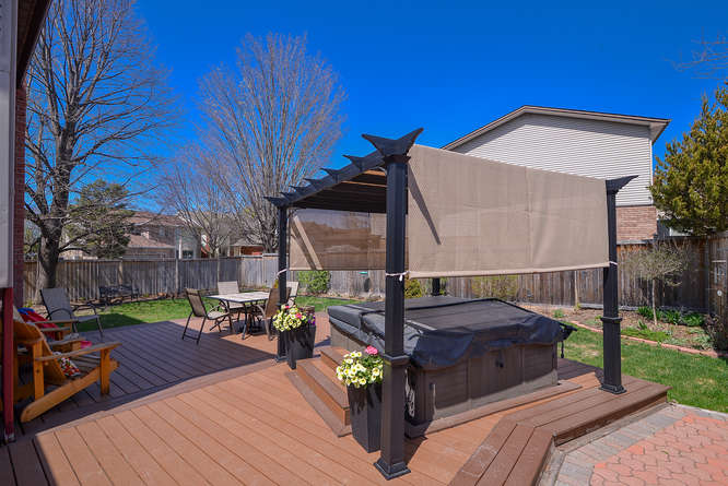 Composite Deck installed in 2013 is maintenance free.  Your backyard oasis comes complete with that hot tub you have been longing for.