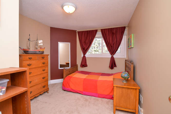 Great sized bedroom with plush carpets and lots of space.