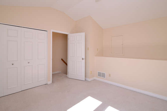 Tons of natural light, great sized room with good closet space and a neat ledge area that the kids will love, or great for office and storage.