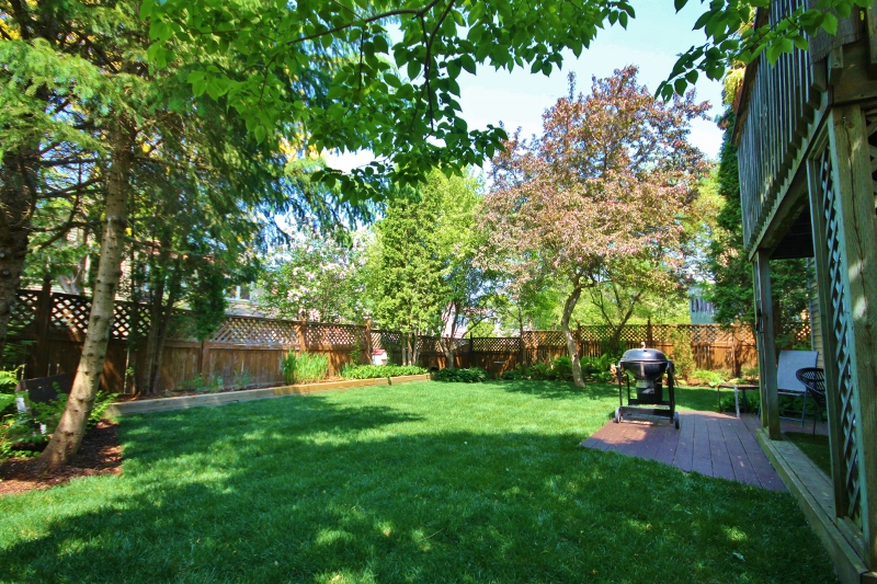 Simply exceptional backyard!  Loads of space for the kids to run and play.  Fully landscaped with fresh sod and perennial gardens.  2nd storey patio and lower level covered deck off lower level walkout.  You wont find better than this!