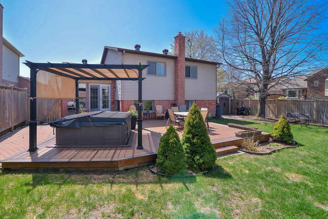 Extremely spacious backyard with newer zero maintenance composite deck, hot tub, storage shed and loads of perennials.  It's BBQ SEASON!