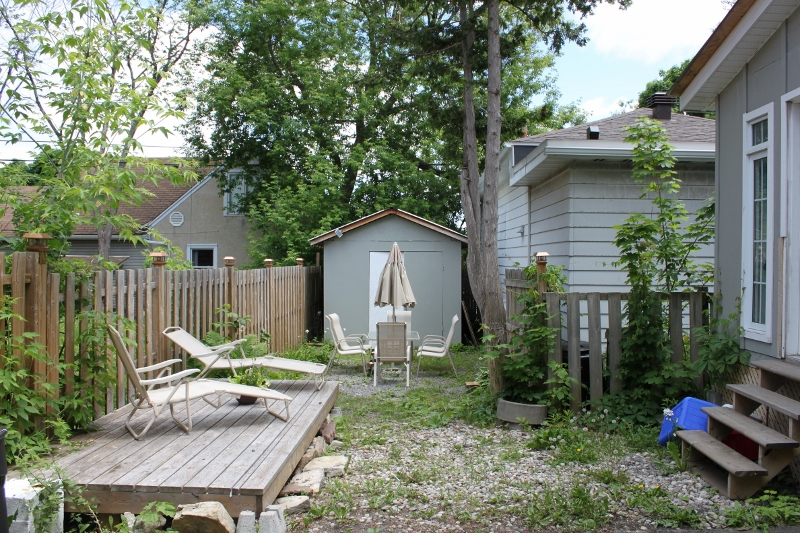 Space for a patio table and lawn chairs, and a large storage shed.