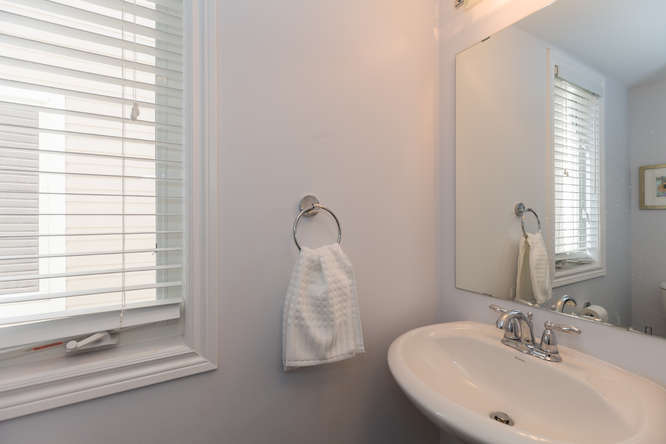 2 piece washroom located on the main level just off the den/office