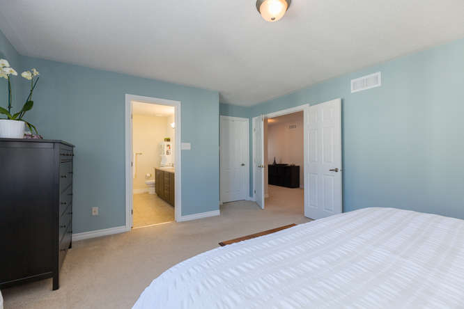 Large master bedroom with spacious walkin closet, and huge master ensuite bath.