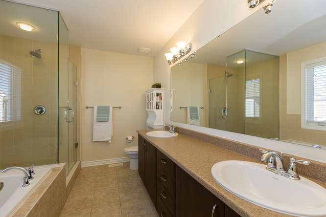 HUGE master ensuite with deep soaker tub, large glass stand up shower, his and her sinks and lots of storage.