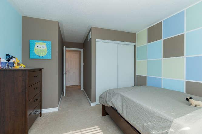 Spacious carpeted bedroom