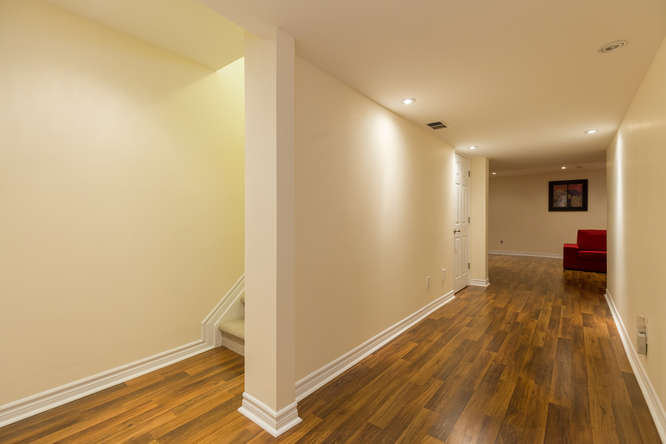 Den/Play area and a Family room on the lower level with beautiful and durable laminate flooring and built in shelving.