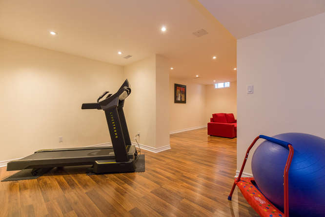 Located off the family room on the lower level, this area makes for a perfect home gym or play area.