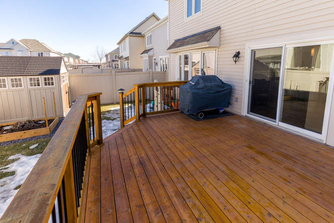 Spacious fenced backyard with large deck perfect for those summer BBQ's, lots of grass for the kids to run and play, and storage shed.