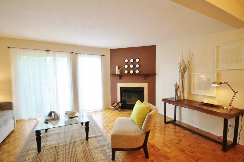 Beautiful Hardwood, loads of natural light, wood burning fireplace.