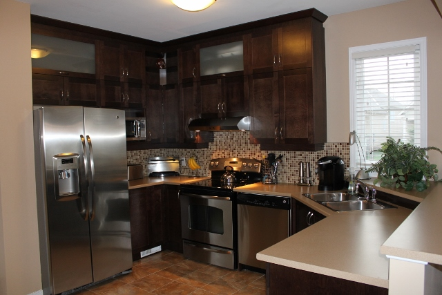 Large Kitchen, lots of counter space and cupboard space.  Ceramic tiling, beautiful cabinets.