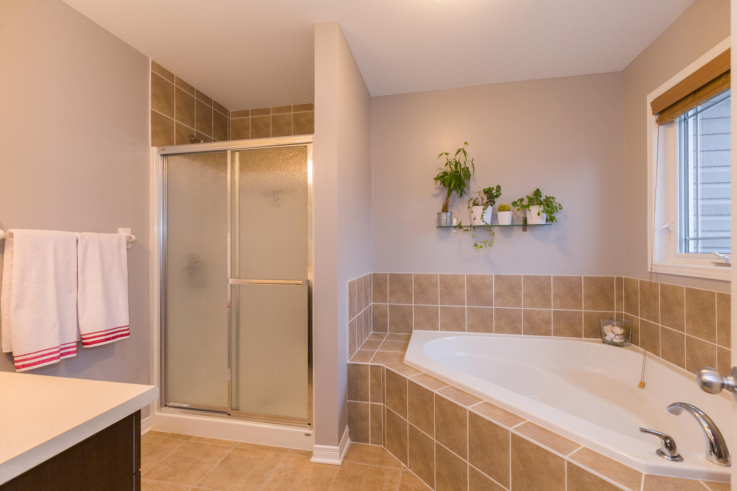 Beautiful ensuite bathroom with stand up shower and large corner soaker tub.