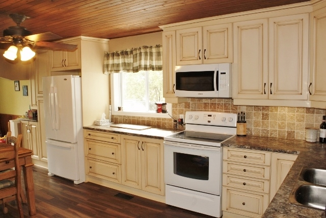 Nicely Renovated Kitchen with Lots of Counter Space and Cabinetry.