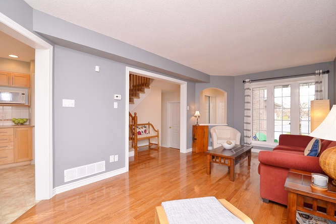 Large main floor living space with beautiful hardwood floor and a double sided gas fireplace.