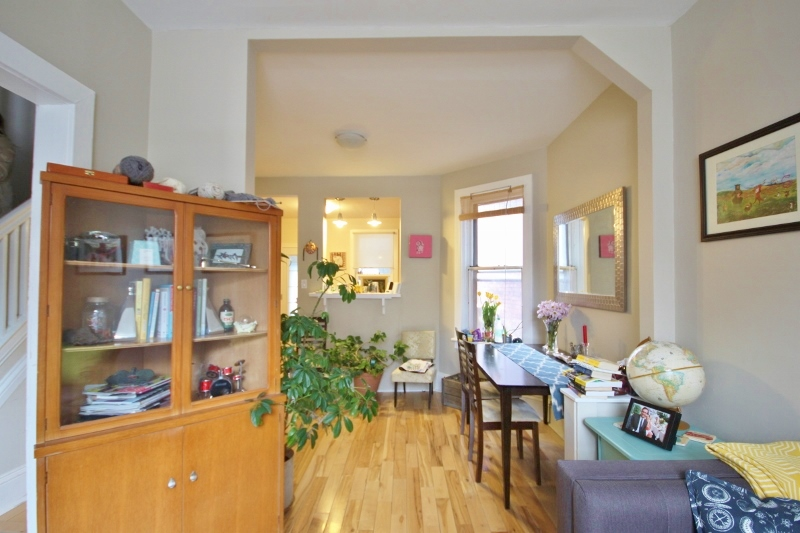Living/dining space in 109. Gorgeous hardwood, lots of natural light.