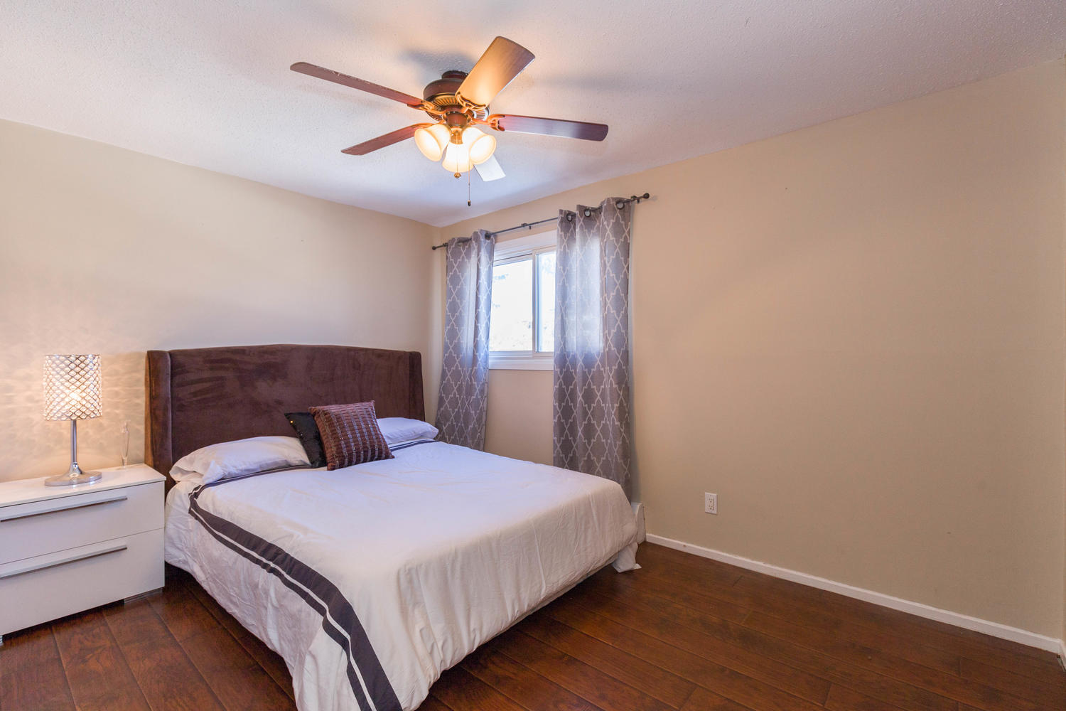 Very spacious and bright master bedroom with wall to wall closets and newer high end laminate flooring