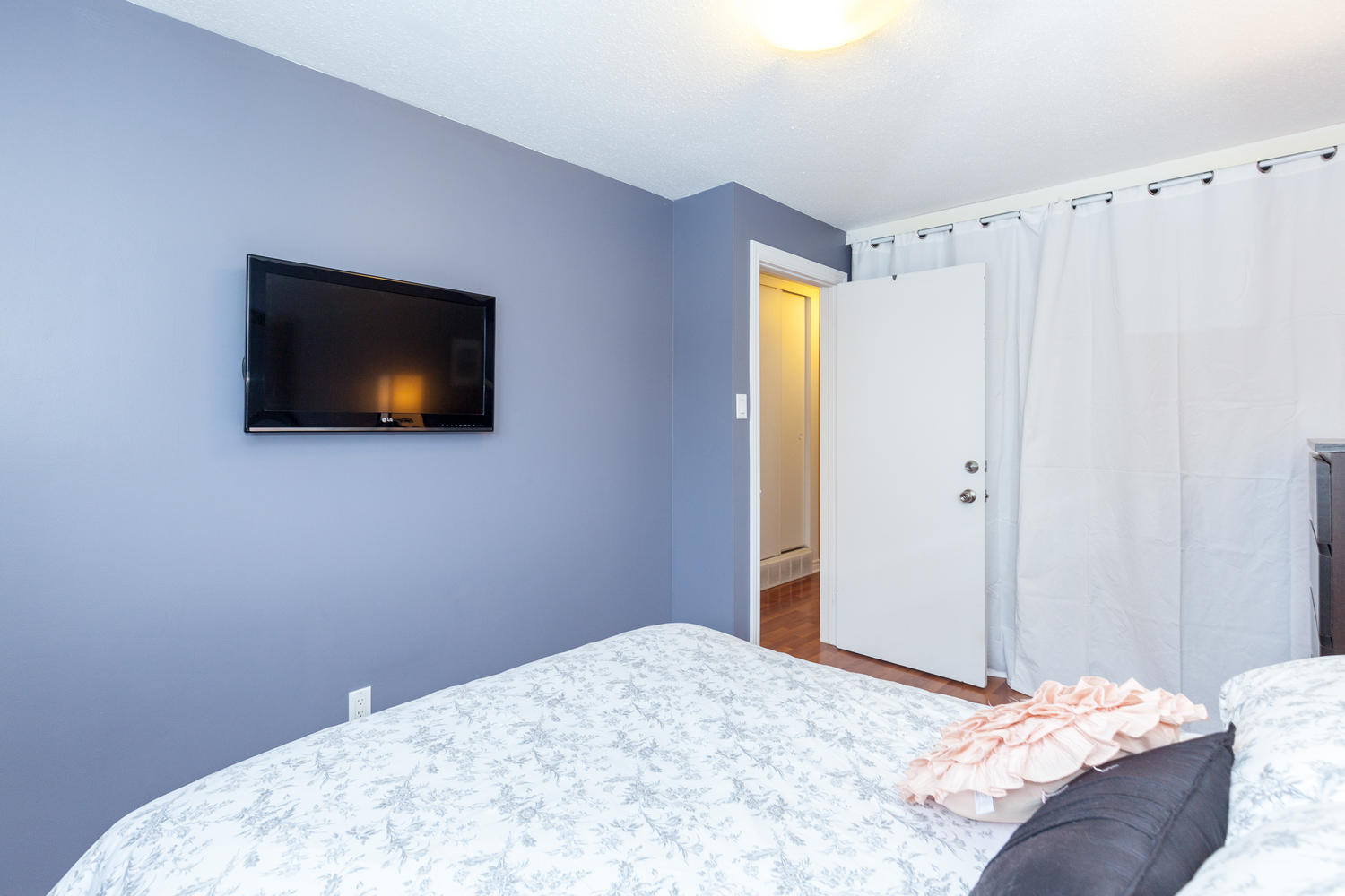 Spacious master bedroom with good closet space.