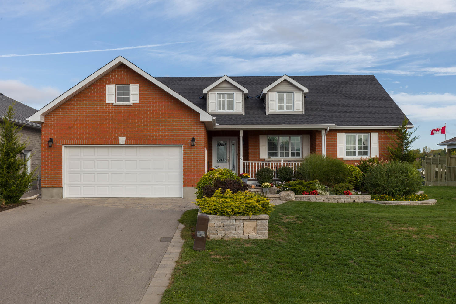 A stunning bungalow on a beautifully landscaped lot.
